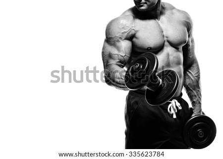 Athlete muscular bodybuilder in the gym training biceps with dumbbell
