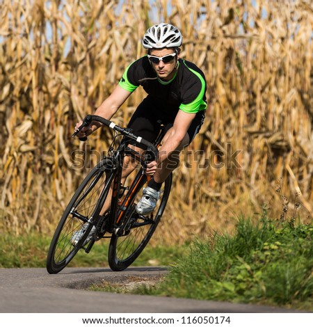 athlete on a race cycle - stock photo