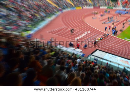 Athlete on the start line before 100 m sprint. Professional athletes preparing for olympic game in Rio.  - stock photo