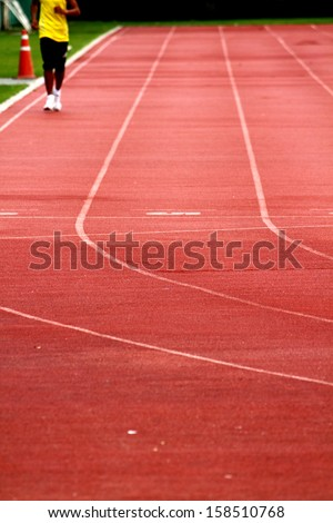 Athlete on track in the stadium