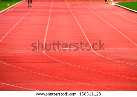 Athlete on track in the stadium - stock photo