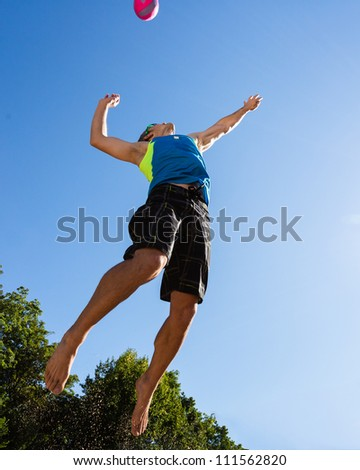 athlete playing beach volleyball - stock photo