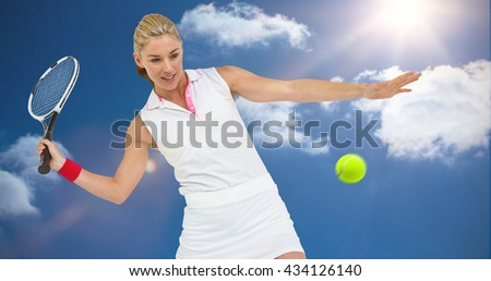 Athlete playing tennis with a racket against bright blue sky with clouds