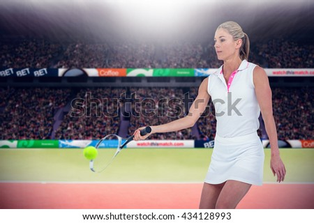 Athlete playing tennis with a racket against composite image of tennis ground with supporters