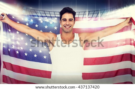 Athlete posing with american flag after victory against american football arena - stock photo