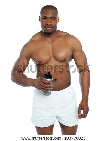 Athlete posing with health drink bottle isolated over white