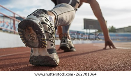 Athlete runner feet running on treadmill.closeup on shoe - stock photo