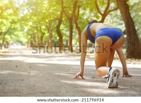 Athlete runner feet running on treadmill closeup on shoe.Female fitness with open space around  - stock photo