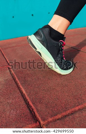 Athlete runner foot, closeup on shoe with copy space