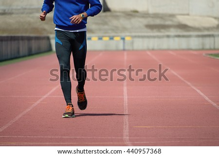 Athlete runner running on athletic track