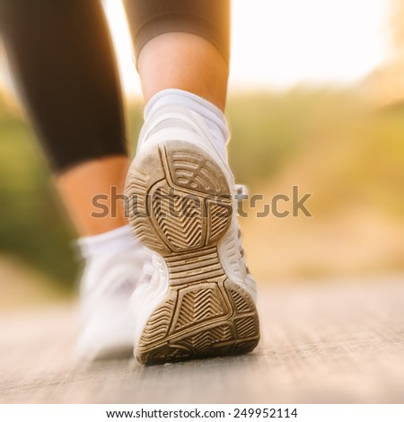 athlete running sport feet in nature healthy lifestyle fitness  - stock photo