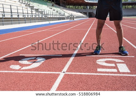Athlete standing on the lane of a running track