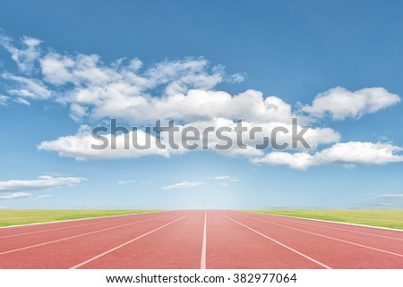 Athlete track or running track with blue sky background - stock photo