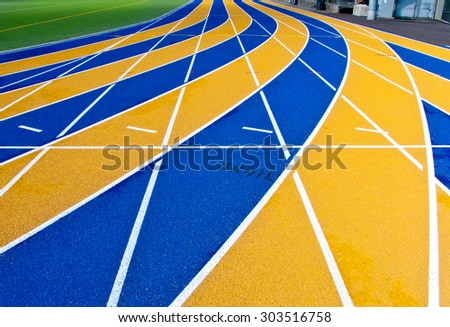Athlete Track or Running Track with colorful numbered lines - stock photo