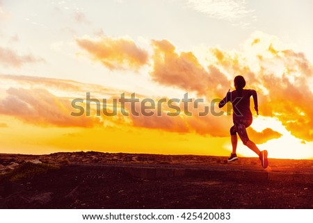 Athlete trail running silhouette of a woman runner at sunset sunrise. Cardio fitness training for marathon race. Active healthy lifestyle in summer nature outdoors. Goal achievement challenge concept.