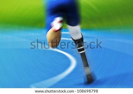 athlete with carbon prosthesis  on race track - stock photo