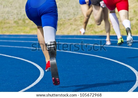 athlete with handicap on race track - stock photo