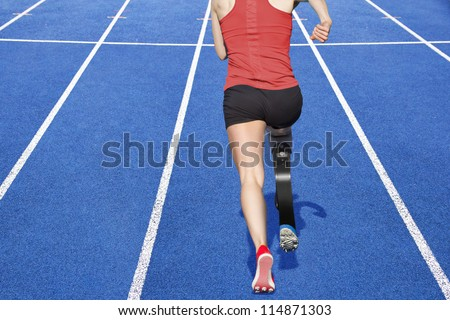 athlete with handicap on race track