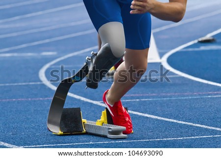 athlete with handicap starts the race - stock photo