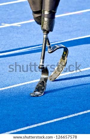 athlete with handicap walks to the start - stock photo