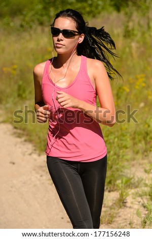 Athlete woman running training on sunny day with sunglasses - stock photo