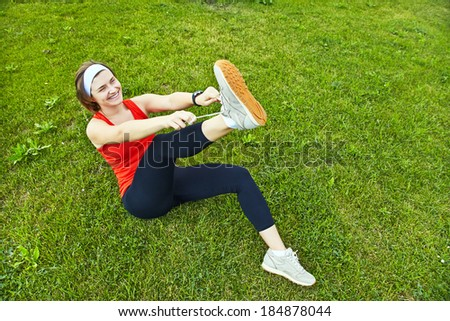 Athlete woman trying running shoes getting ready for jogging - stock photo