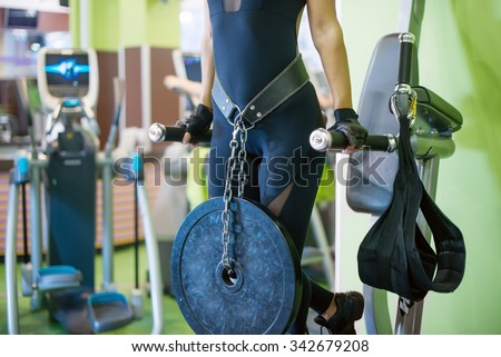 Athlete woman workout out arms on dips horizontal parallel bars Exercise training triceps and biceps doing push ups - stock photo