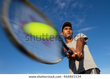 Athlete young men player hit ball tennis With sky blue - Sport Concept