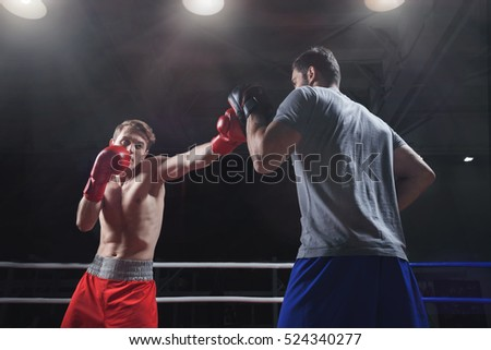 Athletes in a boxing ring