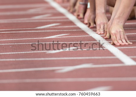 Athletes on the start running. Track and field