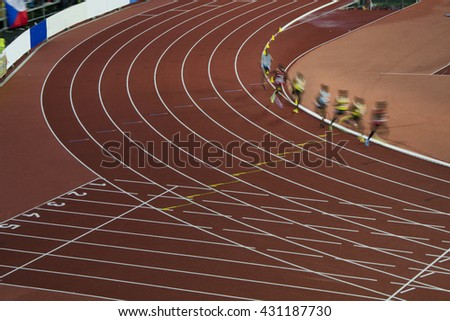 Athletes on the track in motion. Professional race was preparation on olympic game in Rio - stock photo