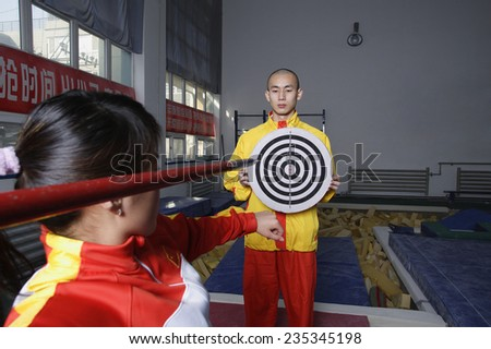 Athletes Practicing Javelin Throw in Gym - stock photo