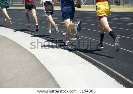 Athletes racing - stock photo