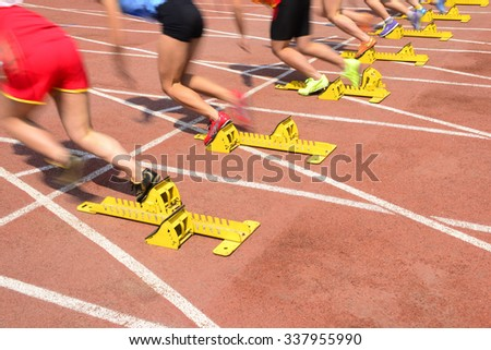 Athletes starting close-up shot of the moment  - stock photo