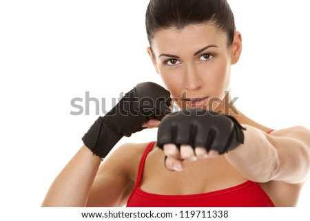 athletic brunette wearing boxing gloves on white isolated background - stock photo