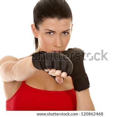 athletic brunette wearing boxing gloves on white isolated background - stock photo