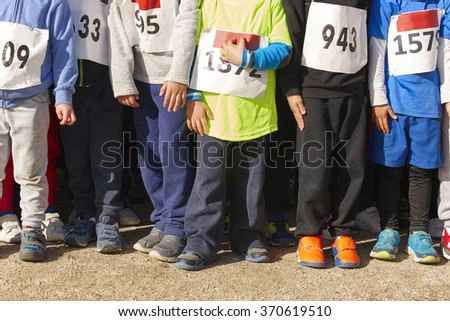 Athletic children ready to start a cross country race. Outdoors. Horizontal - stock photo