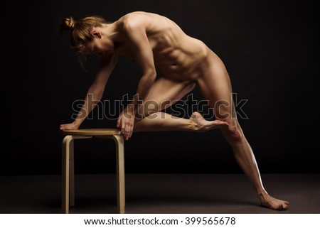 Athletic European fashion model woman with shiny healthy blonde hair, awesome gorgeous slim body and perfect skin, nude in studio for bodycare and wellness advertisement. - stock photo