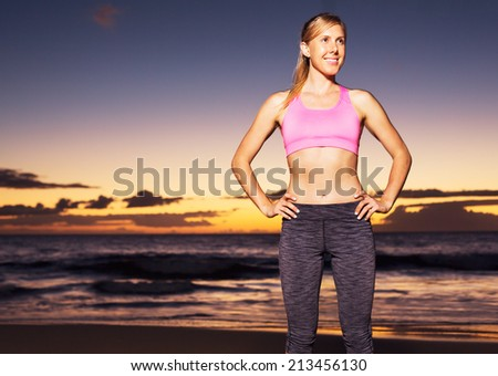 Athletic fitness woman at sunset - stock photo
