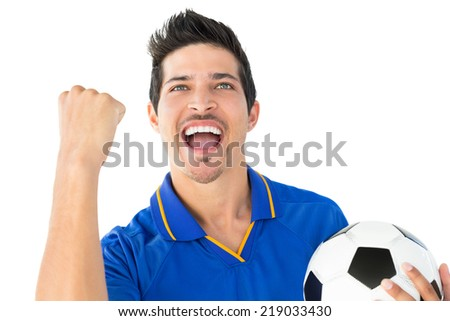 Athletic football player cheering over white background - stock photo