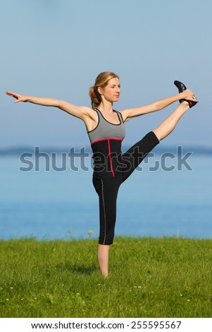 athletic girl, gymnastics at the sea