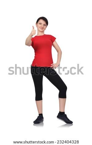 athletic girl showing thumb up on white background - stock photo
