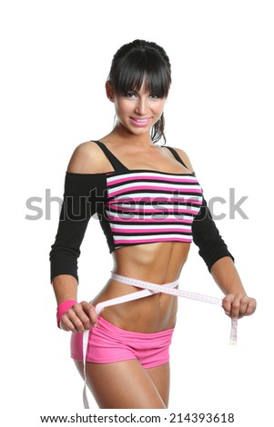 athletic girl with a great figure measures the waist circumference. fitness. excellent health - stock photo