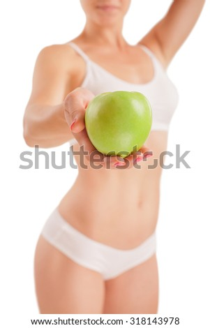 Athletic girl with green apple in hand.