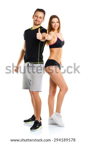 Athletic man and woman after fitness exercise with a thumb up on the white background - stock photo
