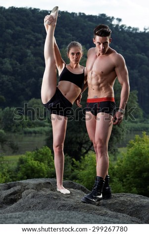 Athletic man and woman outdoor.Fashion photo - stock photo