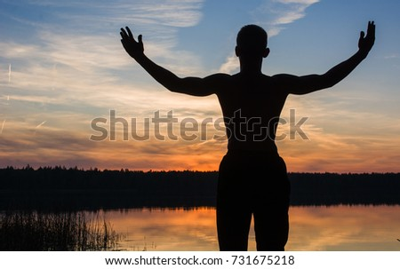 athletic man at sunset