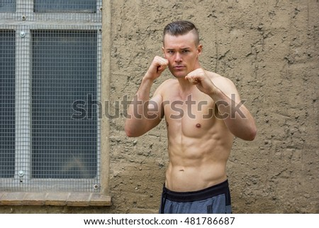 athletic man doing boxing exercises / Boxing Workouts / boxer
