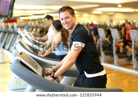 Athletic man during training on a treadmill - stock photo