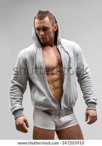 Athletic Man Fitness Model Posing In Underwear and hoodie. - stock photo